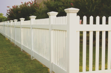 nice-classic-white-picket-fence-made-from-vinyl-material-on-a-nice-orchard
