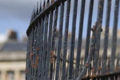 rusted-black-ornamental-wrought-iron-fence